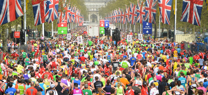 London marathon runners flanked by Union Jacks
