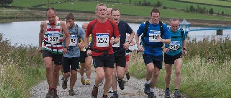 Runners on the hilly Yorkshireman Marathon course
